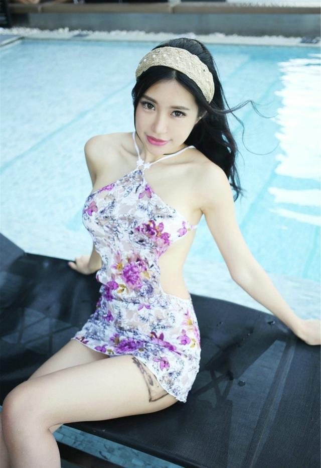 绮里嘉ula旗袍美女性感写真图片(点击浏览下一张趣图)